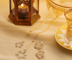 Win three gold pendants from Damas